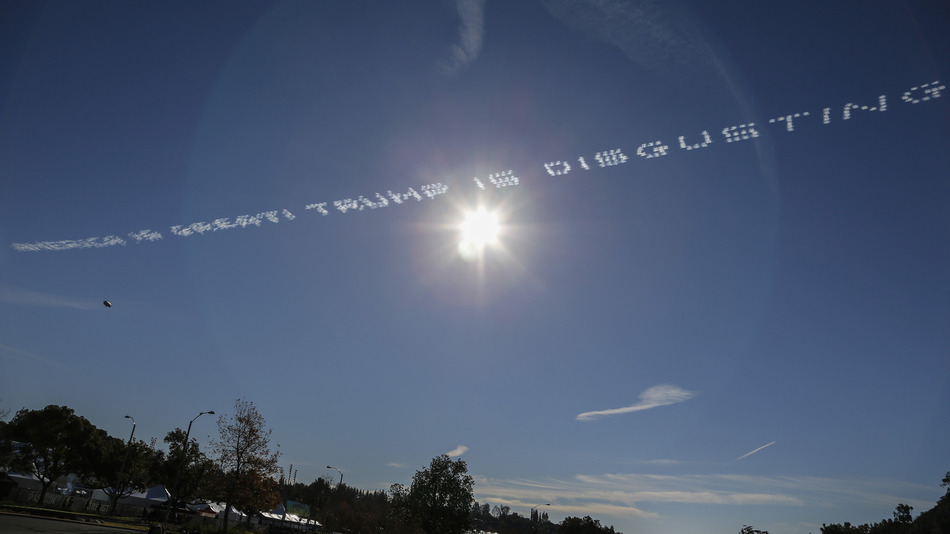 "Political message ""AMERICA IS GREAT. TRUMP IS DISGUSTING"" in sky writing prior to the Rose Bowl, Friday, Jan. 1, 2016, in Pasadena, Calif. (Spencer Allen/IOS via AP Images)"